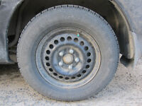 4 Goodyear Nordic Winter tires P215/70R15 with rims
