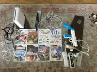 Wii Console + 8 Wii Games + Controllers