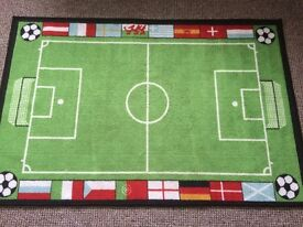 Small bedroom football rug.