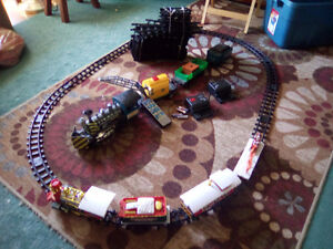 2- battery operated train sets with tracks. Both for 35.00