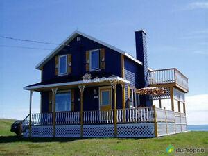 Maison de rêve sur le bord de la mer