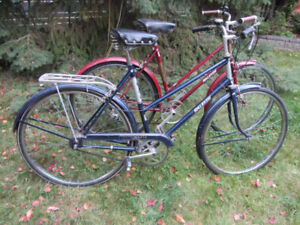 Two Raleigh stepthru bicycles