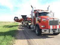 Equipment hauling and air drill towing