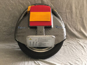USED - Airwheel/Electric Unicycle + Accessories -CBRN Fibre ptrn