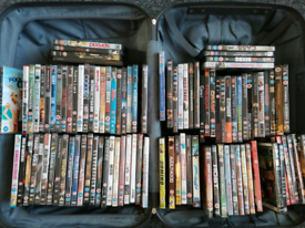 Around 100 DVDs all genres in a Samsonite suitcase