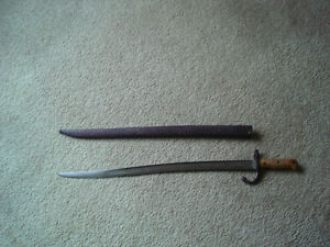 FOR SALE 28 INCH SWORD AND METAL SHEATH FROM 1880'S