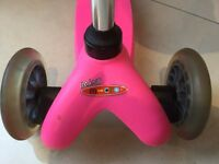 Girls Mini Micro T bar scooter pink and micro helmet .