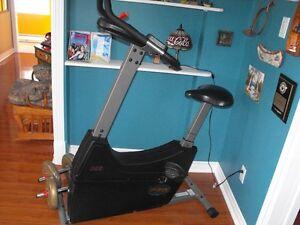 tapis d'exercise et velo stationnaire