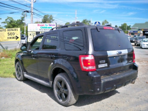 NEW MVI.  09 ESCAPE LIMITED.  +SET TIRES.  READ!!!