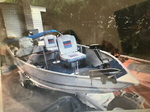 Boat, motor and trailer for sale.
