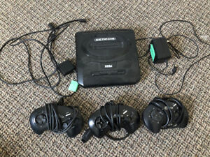 Sega Genesis with cables, 3 controllers, 5 games