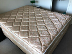 Queen size mattress with matching box spring and bed frame