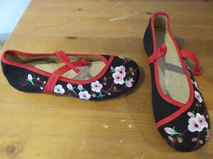 Embroidered canvas flats.