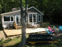 """Lake front cottage for rent """"with sandy beach"""""""
