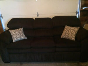 Selling comfy black micro-fibre sofa. No pets, smoke free home