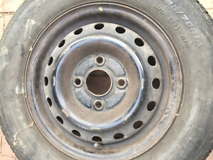 """Two 14"""" tires for sale 185x70x14"""" on 4 bolt rims"""