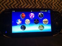 Mint condition is vita with charger and 8gb memory