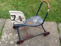 Vintage child's push along tin horse toy