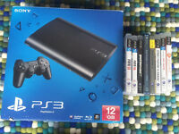 PS3 with 2 controllers & 8 games Gran Turismo, street fighter X tekken