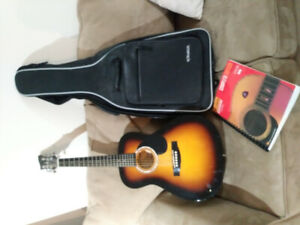 Junior-size guitar with case and book