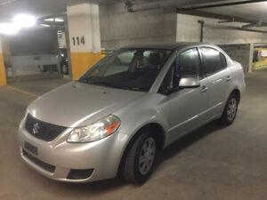 Suzuki SX4, 2009, 89,300 km, argent, $4500; Michel 514 273-9977.