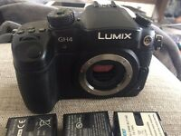 Panasonic GH4 camera body with 3 batteries