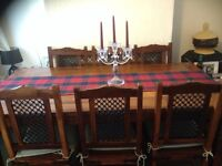 Sheesham dining table and six chairs.