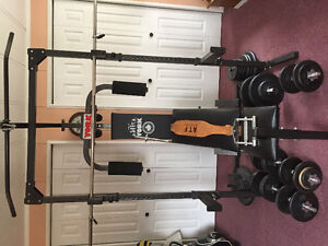 Complete York Universal Gym with bars, weights and bench.