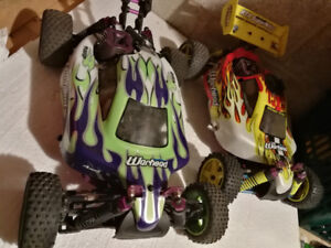 Two HSP Warhead Nitro 4WD RC buggies (Red Cat Tornado clones)