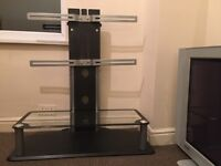 """Black Glass tv stand 32""""37""""40""""42""""50""""60 smarter standFROM SMOKE AND PET FREE HOUSE."""