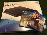 Playstation 4 slim 2016 model as new with battlefield 1 and titanfall 2
