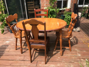 Solid maple dining set with 4 chairs and 2 extensions