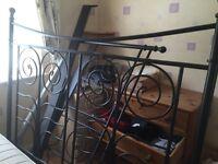Black metal double bed frame