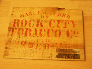 Rock City Tobacco Co. wooden box end with tax label