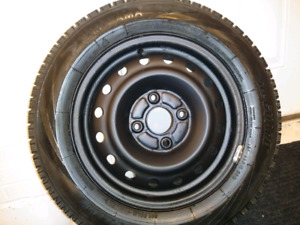185/65/15 A pair of winter tires on steel rims with free deliver
