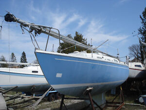 Retirement sale; over a dozen sail boats on cradles must go!