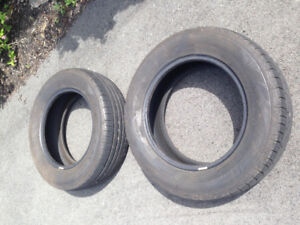 "Two ""Falken 225 / 65R17"" tires."