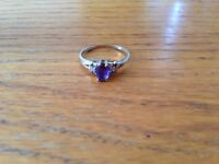 10 k yellow gold ring with Amethyst and two diamonds