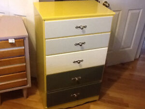 Yellow small dresser with shades of grey