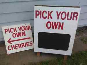 Two farm signs.