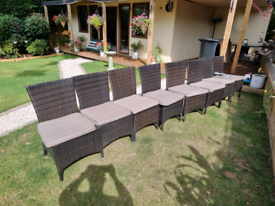 Large Round dinning rattan garden table and 8 chairs £500 can deliver