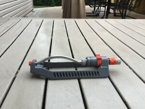 Sprinkler and hose splitter