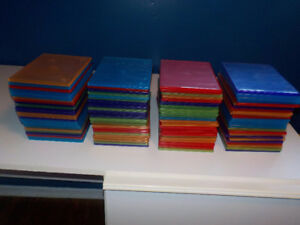 Lot of 100 clear colored DVD cases in VERY GOOD condition