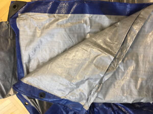 Durable Tarp with fastening holes. Only used once for camping .