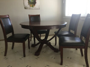 Wooden table w/ leather chairs