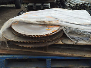 A pallet of wood and metal saw blades