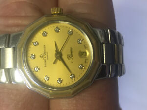 18k solid gold and stainless steel Baume & mercier ladies watch
