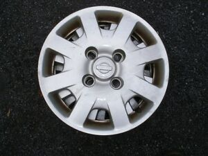 "Set of 4 stock Nissan 14"" hubcaps"