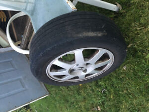 4 original Honda alloy rims , with summers on ,