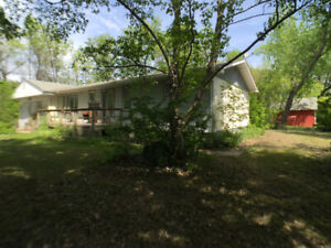 Bungalow on 2 acres just minutes from Portage-make it your own!